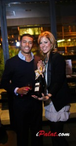 November Event Chair Erin Lyons and Magnum bottle of Chandon raffle winner Jonathan Johnson.