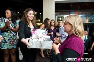Trish McEvoy Nordstrom manager Ashley Yau raffles off a beautiful basket.