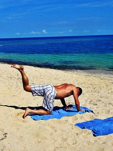 Michael doing yoga on the beach.